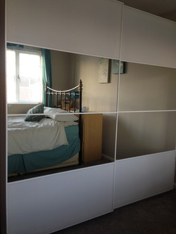 Ikea PAX sliding wardrobes reflecting light into a room assembled by www.norwichflatpack.co.uk