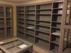 Long run of Ikea Liatorp bookcases and display cabinets assembled by www.norwichflatpack.co.uk