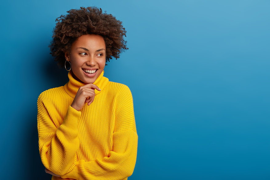 positive-curly-young-woman-dressed-yello