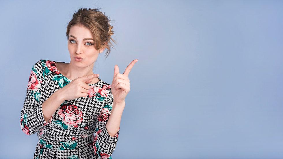 attractive-lady-elegant-dress-pointing-u