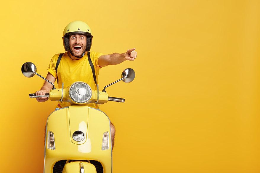overjoyed-guy-with-helmet-driving-yellow