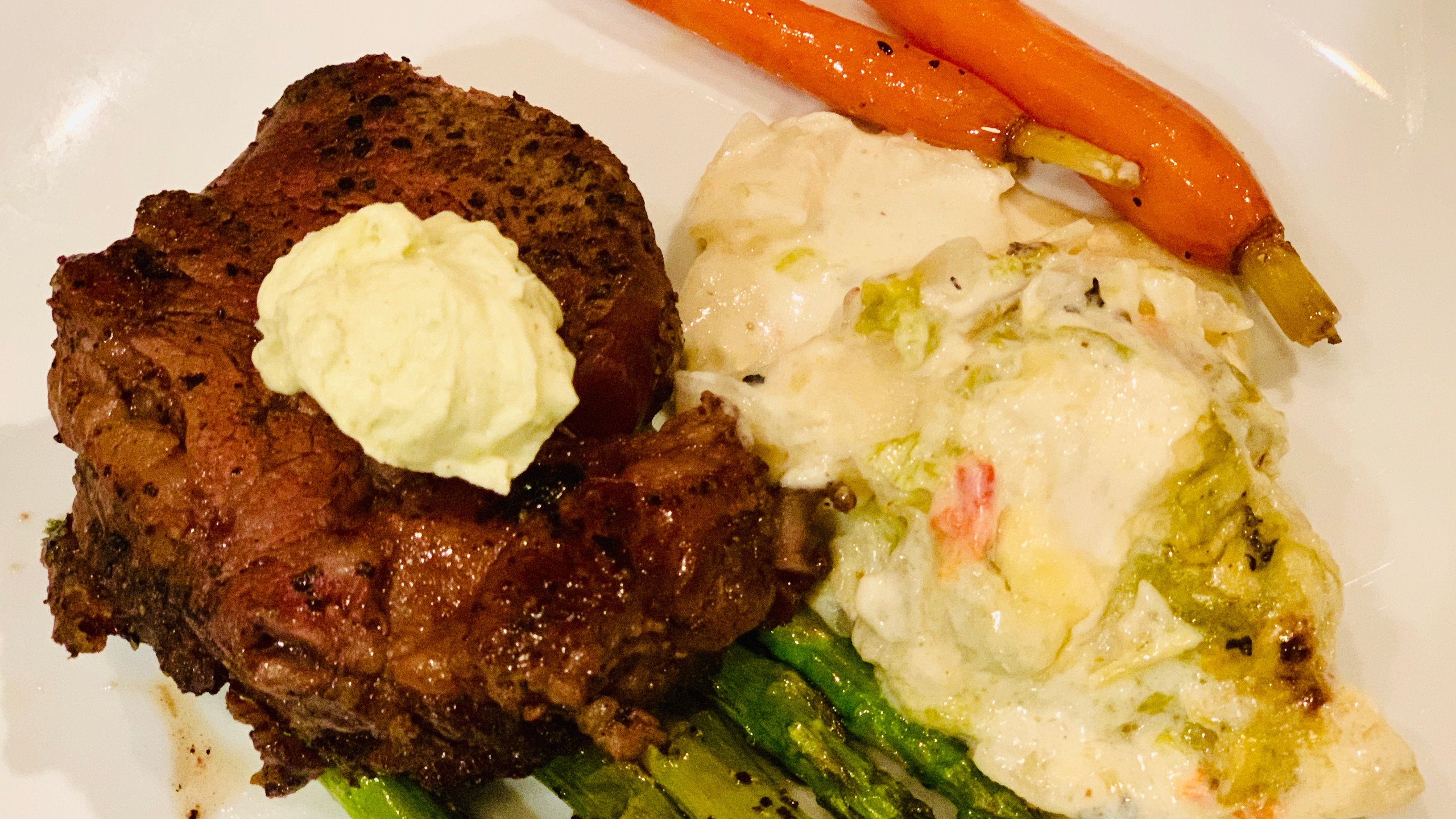 Cast Iron Pan Seared Tenderloin with a Mescal Bernaise, Potato Nest with Green Chile Cream Sauce, Agave Glazed Baby Carrots, Grilled Asparagus