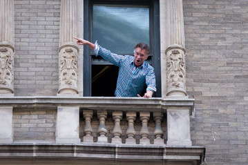 Broadway actor and singer Brian Stokes Mitchell sings out the window of hs apartment on Broadway on the Upper West Side.(Gardiner Anderson/for New York Daily News)
