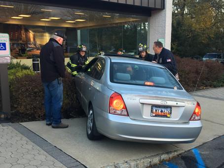 Vehicle narrowly misses striking TD Bank