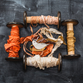 Silk ribbon on wooden spools