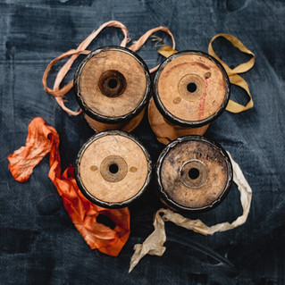 vintage wooden spools with silk ribbon.
