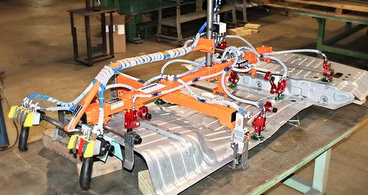 Henshaw floor pan vacuum cup lift assist