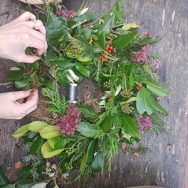 Christmas wreath finishing touches