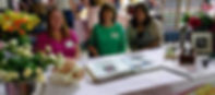 Our educational table at a recent baby fair: Tammie, Anne and Alisha