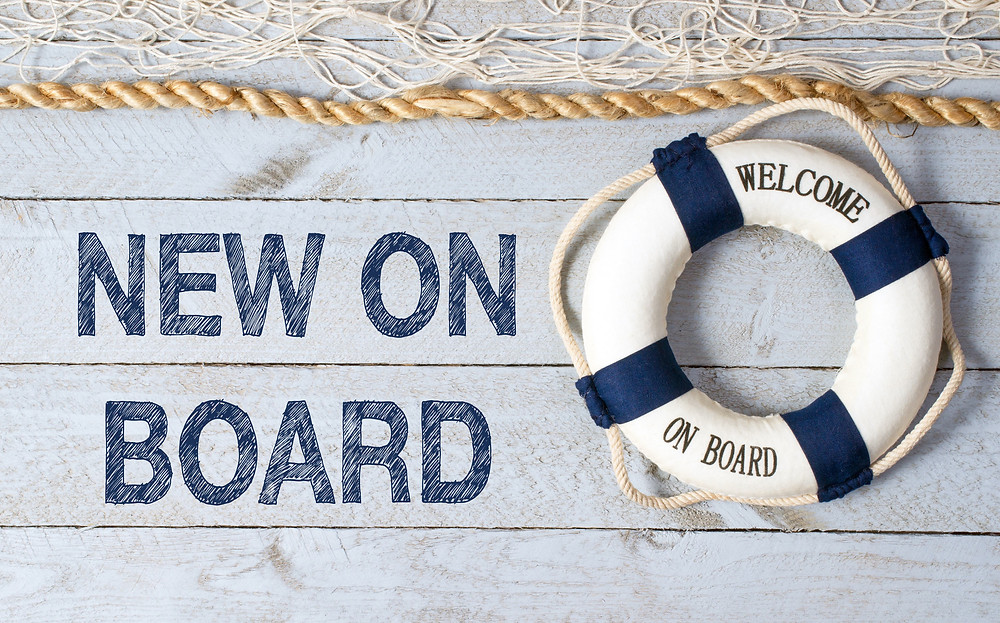 "life preserver ring and words ""NEW ON BOARD"""