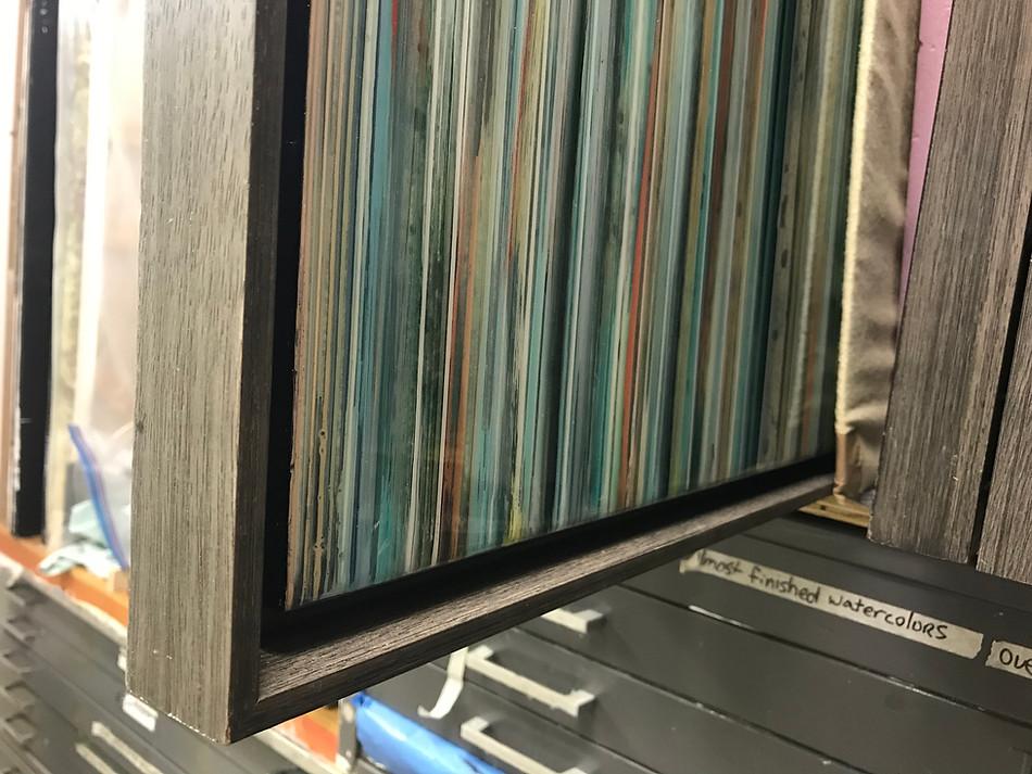 Framed works are permanently attached inside wood floater frames.