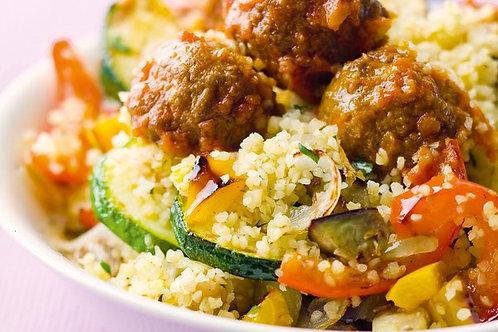 Couscous aux légumes grillés, boulettes d'agneau, chipolata & merguez
