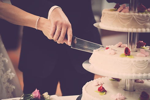 Canva - Person Holding Knife Slicing 3-layer Cake.jpg