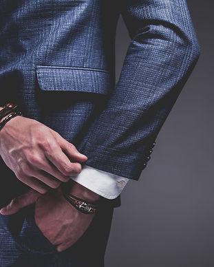 Fashion portrait of young businessman ha