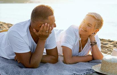 medium-shot-couple-laying-towel_edited.j