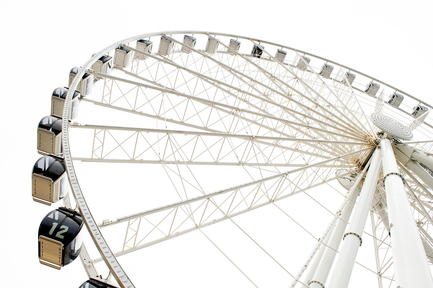 The Seattle Great Wheel honors the famous Seahawk's 12th man with the number painted on one of their carriages. Seattle, WA. 2019.