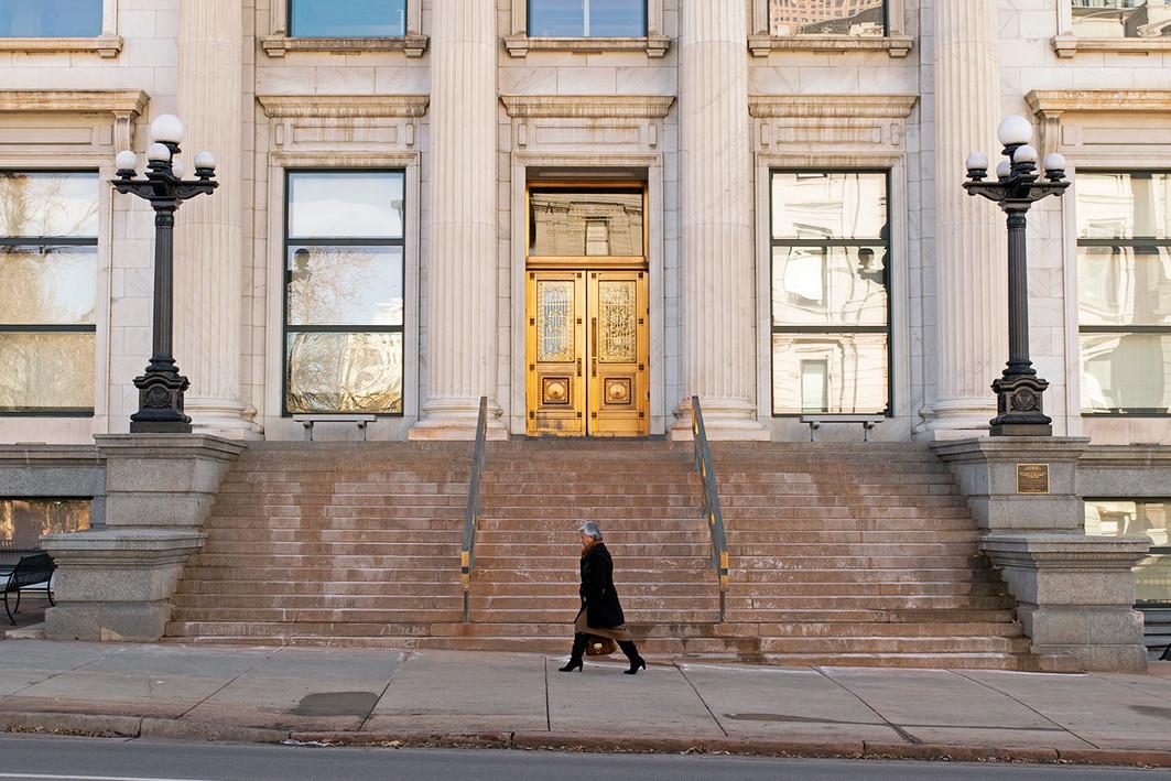 Strolling by the Denver Legislative Services Building in downtown Denver. Capitol Hill, Denver, CO. January, 2020.
