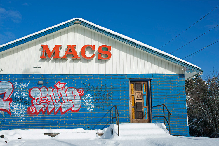 The front of MAC's Motel on a bright winter day, with years of graffitti. Bellingham, WA. 2018.