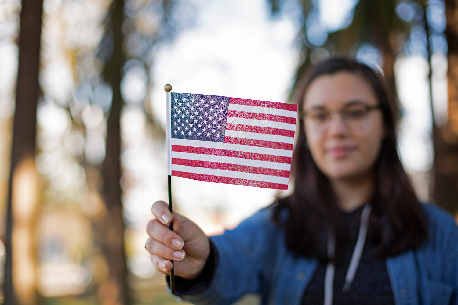 Sara Borgeau holds the American flag she recieved with her citizenship package when she and her family, all from Canada, became American citizens. Her father made sure they were all naturalized before the 2016 elections so they could vote for the first time as Americans. 2019.