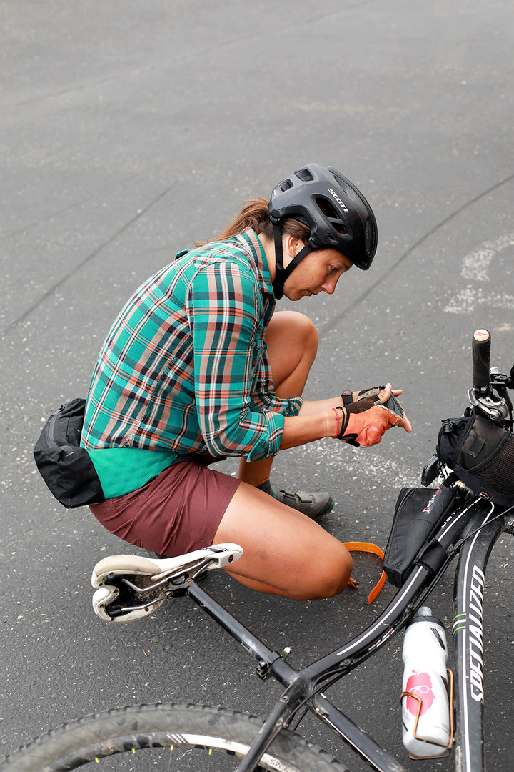 One member of Shifting Gears prepares her bike before heading out on an overnight recreation trip with other members. June 10, 2019. Bellingham, WA.