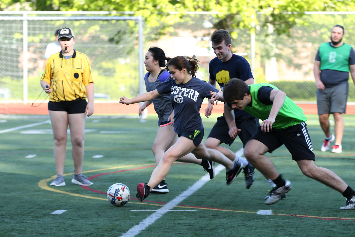 Intramural soccer teams clash during a game in the Spring quarter of Western Washington University. Bellingham, WA. 2018.