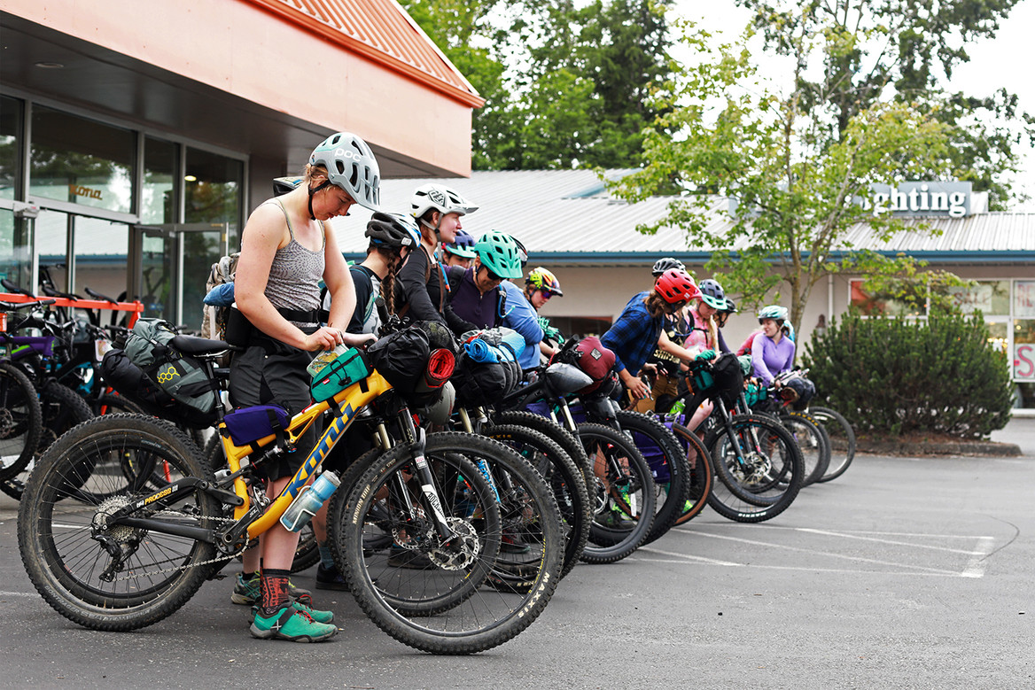 Members of the Shifting Gears outdoor recreation nonprofit line up their before heading out on an overnight trip. June 10, 2019. Bellingham, WA.