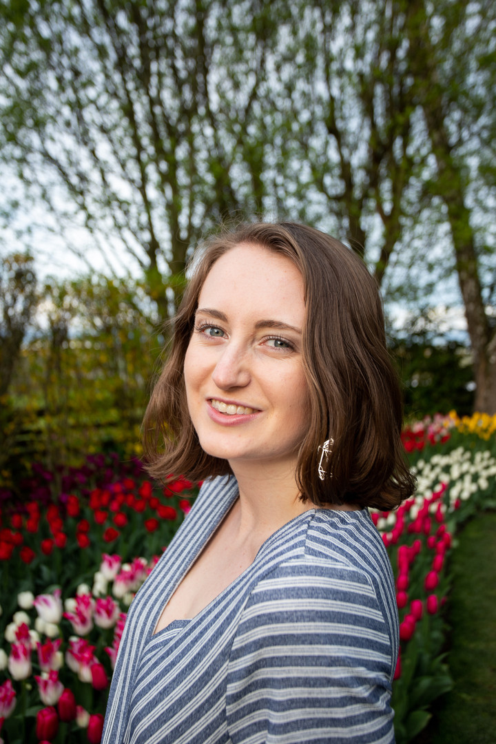 Hailey Hoffman poses for senior portraits amongst the tulip gardens in Skagit Valley, Washington. 2019.