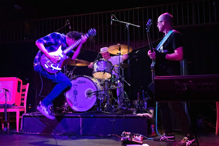 Old members of the Bellingham-born Pushing Up Posies band rock out together during their reunion concert at The Wild Buffalo in downtown Bellingham. It has been 30 years since the indie band had first been formed. July 6, 2018. Bellingham, WA.