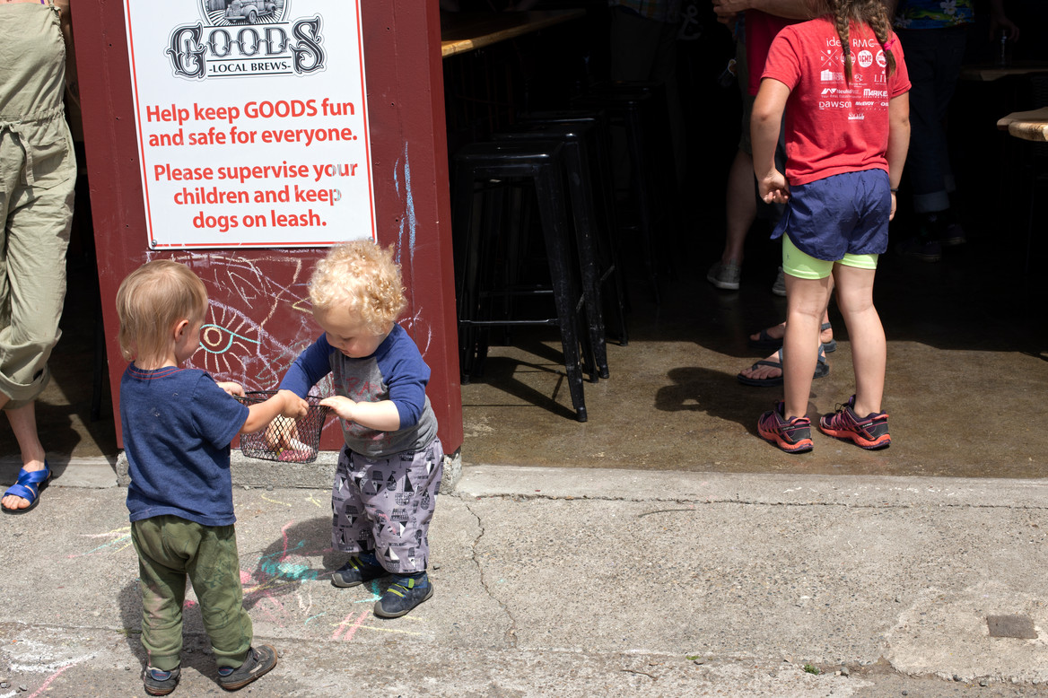 Two young artists explore the chalk bin at the Handmade Market run at Goods Nursery. Bellingham, WA. April, 2019.