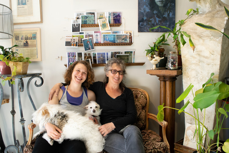 Cooper Lanza (right) and her daughter Morgan (left) sit with their two dogs in Cooper's art gallery located in the Fairhaven neighborhood of Bellingham, Washington. Lanza and her daughter opened Cooper Lanza Gallery and School of Fine Art in April 2016, which Lanza teaches painting classes and exhibits her own work.
