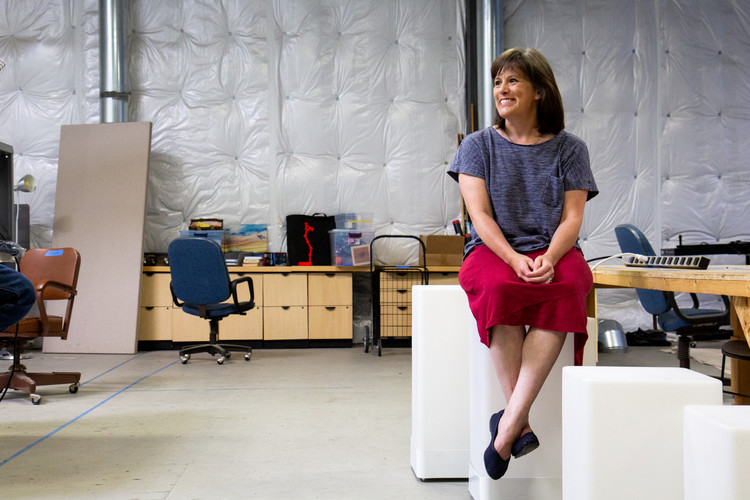 Mary Elliott, an occupational therapist and founder of The Makerspace, sits upon one of the many sculptural projects that inhabit The Makerspace, a nonprofit that connects creative resources with Bellingham creatives to enhance artisitcia and STEM-based learning.