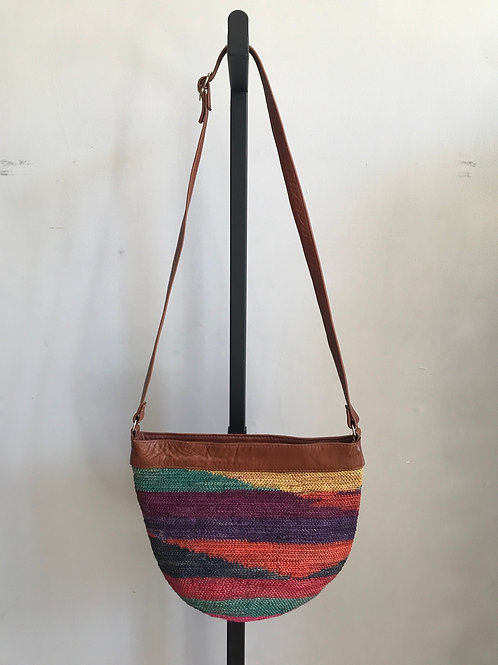 Woven crossbody with leather strap