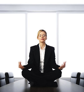 Woman-in-business-suit-meditation_232541