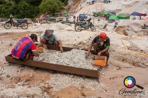 Miners sorting to find gemstones Mogok.j