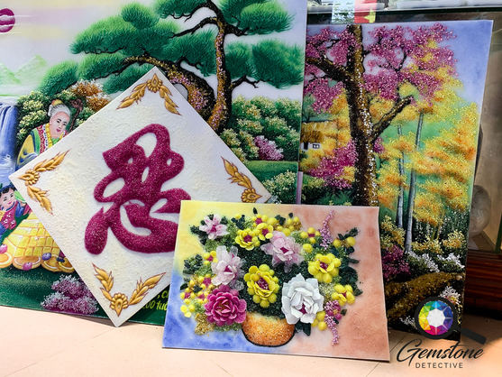 Handcrafted gemstone paintings on show i