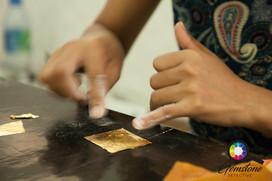 Gold leaf making, Myanmar.jpg