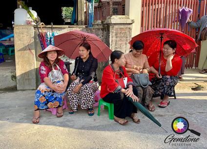 Burmese women selling gemstones in Mogok