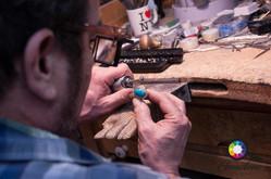 Jeweller making turquoise jewellery in U