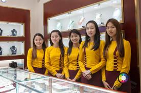 Female shop staff in their uniforms, Mya