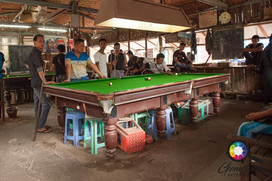 Traders play snooker at the jade market