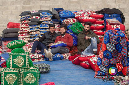 Traders selling cushions and blankets in