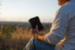 Man-in-Field-with-Bible.jpg