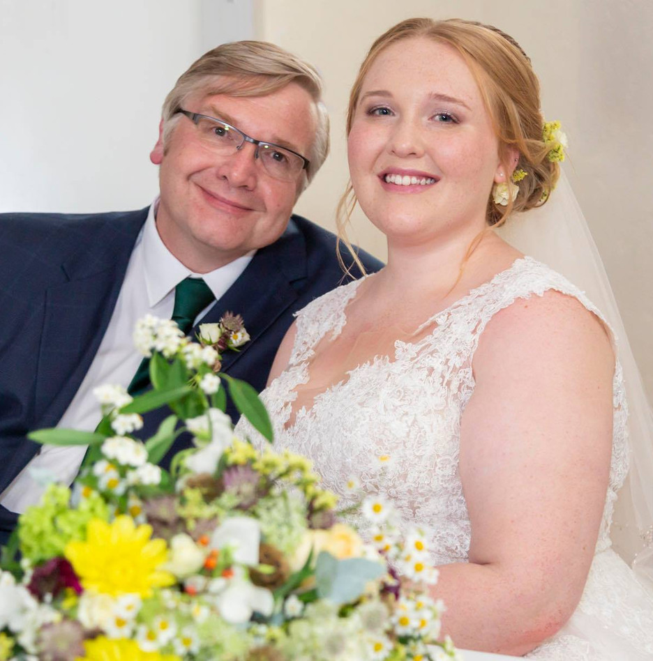 Lucy looking fab with her Dad on the big day.