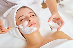 Woman in mask on face in spa beauty salo