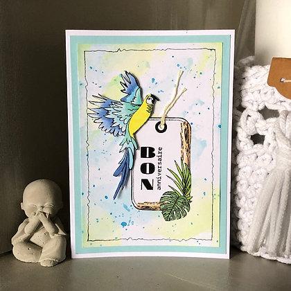 Carte ''Bon anniversaire'' avec un perroquet jaune et dégradé de bleus
