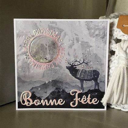 Carte à secouer ''Bonne Fête et Merry Christmas'' avec un cerf