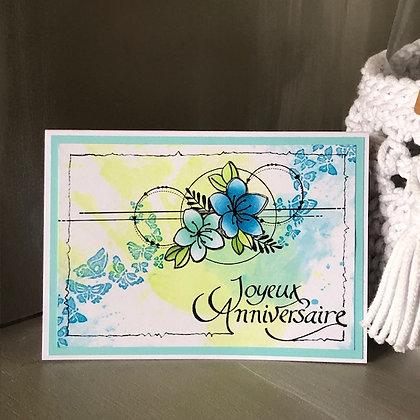Carte ''Joyeux anniversaire'' avec fleurs et papillons