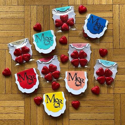 Petits paquets ''MERCI beaucoup'' avec coeur en chocolat