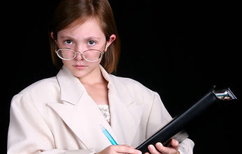 Female actor playing a doctor holding a folder with pen