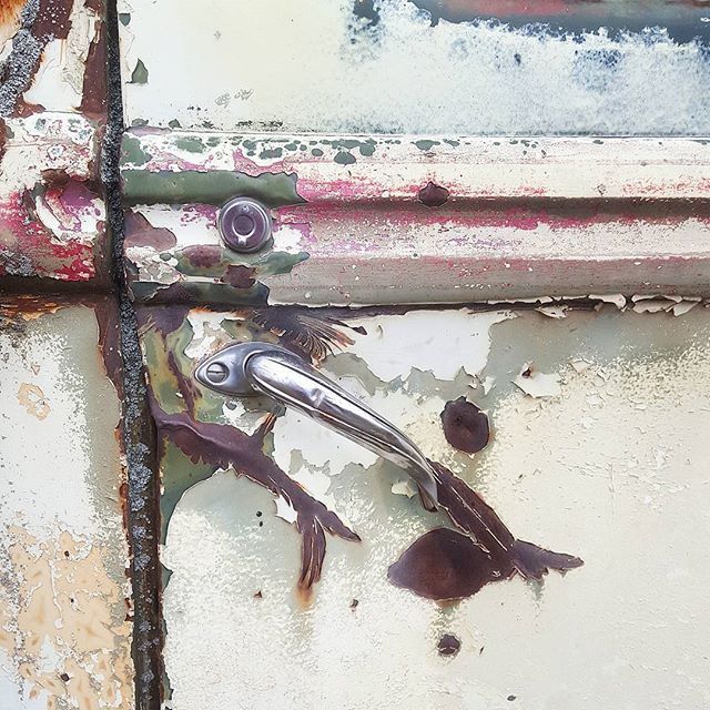 close up of the rusty fords door